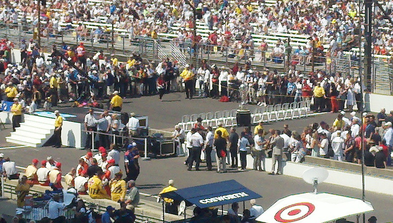 Dignitaries waiting for drivers to be introduced--they enter in their rows of 3