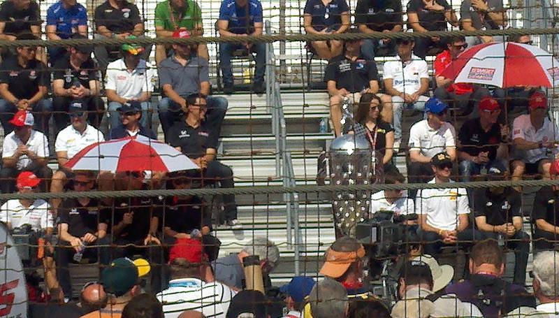 Bottom Left:  Tony Kanaan in white shirt and then JR HIldebrand next to him w/dark shades