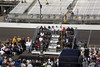 Saturday Drivers' Meeting--all 33 drivers in the bleachers with the Borg Warner Trophy on a stand in front of them.