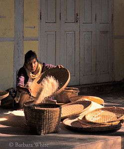 Woman Cleaning Rice
