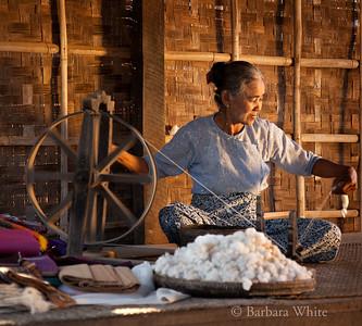 Village Woman Spinning Wool