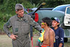 Brazilian Air Force (FAB) Col. Jose Hugo Volkmer, left, talks with Yanomami indigenous men on an airstrip on the Yanomami reserve in Roraima state, Brazil. Health conditions for the Yanomami have improved ever since the beginning of relief missions by the FAB. The FAB uses its infrastructure and know-how to promote a three part policy for the remote Amazon region near the Venezuela and Guyana borders: To show a presence of state in the inaccessible area, by taking medical personnel to those areas and finally, to train pilots in during real-life relief missions in an extreme environment. The increased presence in the area is, in part, to combat drug trafficking from Colombia into Brazil through Venezuela, which has increased after borders areas with Colombia have become more secure. Some say it may also be a reaction to Venezuela's recent acquisition of Russian-made helicopters and fighter jets. (Australfoto/Douglas Engle)