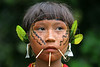 A Yanomami indigenous girl waits for medical treatment near a Brazilian Air Force (FAB) airstrip on the Yanomami reserve in Roraima state, Brazil. Health conditions for the Yanomami have improved ever since the beginning of relief missions by the FAB. The FAB uses its infrastructure and know-how to promote a three part policy for the remote Amazon region near the Venezuela and Guyana borders: To show a presence of state in the inaccessible area, by taking medical personnel to those areas and finally, to train pilots in during real-life relief missions in an extreme environment. The increased presence in the area is, in part, to combat drug trafficking from Colombia into Brazil through Venezuela, which has increased after borders areas with Colombia have become more secure. Some say it may also be a reaction to Venezuela's recent acquisition of Russian-made helicopters and fighter jets. (Australfoto/Douglas Engle)