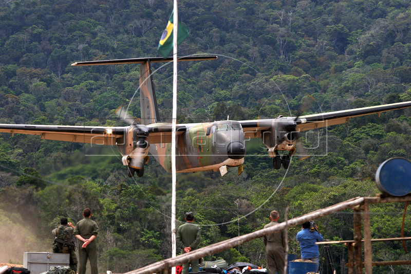 Brazilian Air Force (FAB) Buffalo cargo plane takes off from the Carambatai airstrip during a relief mission to remote areas of Roraima state, Brazil. The Brazilian Air force has adopted a three part policy for the remote Amazon region near the Venezuela and Guyana borders: To show a presence of state in the inaccessible area, by taking medical personnel to those areas and finally, to train pilots in during real-life relief missions in an extreme environment. The increased presence in the area is, in part, to combat drug trafficking from Colombia into Brazil through Venezuela, which has increased after borders areas with Colombia have become more secure. Some say it may also be a reaction to Venezuela's recent acquisition of Russian-made helicopters and fighter jets. (Australfoto/Douglas Engle)