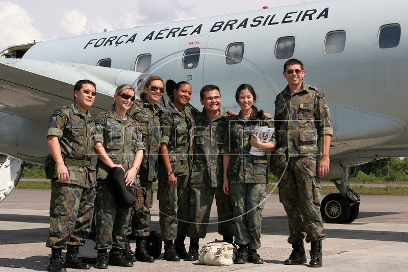 Doctors and dentists of the Brazilian Air Force (FAB) pose near a FAB plane upon embarking on a relief mission to remote areas of Roraima state from Manaus, Brazil. The Brazilian Air force has adopted a three part policy for the remote Amazon region near the Venezuela and Guyana borders: To show a presence of state in the inaccessible area, by taking medical personnel to those areas and finally, to train pilots in during real-life relief missions in an extreme environment. The increased presence in the area is, in part, to combat drug trafficking from Colombia into Brazil through Venezuela, which has increased after borders areas with Colombia have become more secure. Some say it may also be a reaction to Venezuela's recent acquisition of Russian-made helicopters and fighter jets. (Australfoto/Douglas Engle)