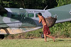 A Yanomami indigenous man walks past a Brazilian Air Force (FAB) Cessna Caravan on an airstrip on the Yanomami reserve in Roraima state, Brazil. Health conditions for the Yanomami have improved ever since the beginning of relief missions by the FAB. The FAB uses its infrastructure and know-how to promote a three part policy for the remote Amazon region near the Venezuela and Guyana borders: To show a presence of state in the inaccessible area, by taking medical personnel to those areas and finally, to train pilots in during real-life relief missions in an extreme environment. The increased presence in the area is, in part, to combat drug trafficking from Colombia into Brazil through Venezuela, which has increased after borders areas with Colombia have become more secure. Some say it may also be a reaction to Venezuela's recent acquisition of Russian-made helicopters and fighter jets. (Australfoto/Douglas Engle)