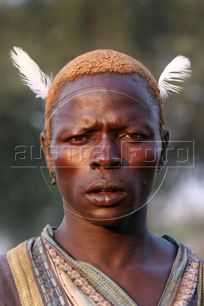 A Dinka herder at a cattle camp near Mapuordit in the semi-autonomous south Sudan, Nov. 23, 2005. The Dinka is one of the largest tribes of south Sudan, inhabiting the swamplands of the Bahr el Ghazal region of the Nile basin. They are mainly pastoral people, relying on cattle herding at riverside camps in the dry season and growing millet (Anyanjang) in fixed settlements during the rainy season. Among well-known Dinka are supermodel Alek Wek, former NBA player Manute Bol, one of the two tallest players in the league's history and current NBA player Lual Deng. A Jan. 2005 peace accord ended a 21 year civil war in Sudan, in which some 1.5 million were killed. The wat pitted the Muslim-dominated government in Khartoum against the mainly Christian and anamist south. The peace deal includes wealth and power-sharing arrangements, created a national unity government in Khartoum and gives southern Sudan a six-year period of autonomy after which it will hold a referendum on secession. (Douglas Engle/Australfoto)