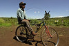 A Kiawah man sits on a bicycle at a camp of Kiawah Indians in Brazil's Mato Grosso do Sul state. (Australfoto/Douglas Engle)