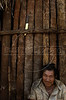 A mans sits outside a house at a camp of Kiawah Indians in Brazil's Mato Grosso do Sul state.  (Australfoto/Douglas Engle)
