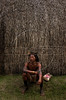 A member of the Kraho tribe sits in front of a replica Kraho home at the Museum of the Indian in Rio de Janeiro,  Brazil, Sunday, April 16, 2000. Several Kraho, from Brazil's northern Toncantins state were at the museum to speak with vistors as part of festivities for Brazil's 500th anniversary, April 22. (Australfoto/Douglas Engle)