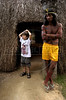 A member of the Kraho tribe stands in front of a replica Kraho home as a boy stands nearby at the Museum of the Indian in Rio de Janeiro,  Brazil, Sunday, April 16, 2000.  Several Kraho, from Brazil's northern Toncantins state were at the museum to speak with vistors as part of festivities for Brazil's 500th anniversary, April 22. (Australfoto/Douglas Engle)