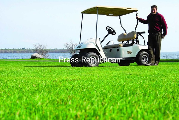 "Bluff Point Golf Resort owner and President of Golf Operations Paul Dame said the recent run of warm, sunny weather led to the club's best opening of a season ever. ""Things dried up amazingly fast,"" he said. ""We had to get our irrigations system up and running about three weeks ahead of time.""<br><br>(P-R Photo/Rachel Moore)"