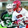 Plattsburgh State's Frank Sangiovanni (32) tries to move past Morrisville State's Tom Moore (5). Sangiovanni set a scoring record with nine goals as the Cardinals won, 21-6.<br><br>(Staff photo/Rob Fountain)