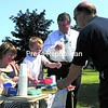 David Stanley (right) and Patrick McGill buy lemonade from Ian Bova's Lemonade Stand. Ian is getting ready for second grade and learning about money with his first-grade teacher Erin McGill (left) at Bailey Avenue Elementary School. <br><br>(P-R Photo/Kelli Catana)
