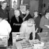 Elizabethtown Community Food Shelf volunteers (front, from left) Judy Salg, Jean Curtis and Katharine Preston load some of the Food Shelf baskets, while (back, from left) John Bingham, Charlie Martin, Sharon Martin, Ann Marie Speir and Marilyn Jordan take a break.<br><br>(Staff Photo/Alvin Reiner)