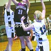Chateaugay's Danielle Swanston (21) attempts layup between Chazy defenders Stephanie Pepper (left) and Alys Lyons (13) in Chazy Shootout Tuesday. Chateaugay won 67-38.<br><br>(P-R Photo/Michael Betts)