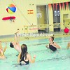 The Plattsburgh High School girls varsity basketball team hosted a Kids Night Out fundraiser Monday night at Stafford Middle School. From left, varsity players Krissy Flynn, Emily Higgins, Avery Vilbert, Lauren Grady and Bailey Rabideau play ball in the pool with Rosa and Jack Gasper. Children who attended also played games in the gym. <br><br>(Staff Photo/Kelli Catana)