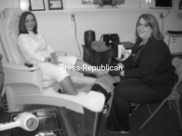 Samantha Bombard (right), who recently opened Samantha's Salon at 14227 State Route 9 (Main Street) in AuSable Forks, gives a pedicure to a customer, Trista Goodman. She provides all hair-care services for men, women and children in addition to manicures, pedicures and waxing. With seven years of experience in hair care, she is open Tuesday and Thursday from 10 a.m. to 7 p.m., Wednesday and Friday from 9 a.m. to 5 p.m. and Saturday from 9 a.m. to 2 p.m. Walk-ins are welcome. For more information, she can be reached at 647-2180.<br><br>(Staff Photo/Kelli Catana)