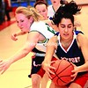 Westport's Valentina Rodriquez (right) battles Elizabethtown-Lewis' Riley Diemand (left) for possession of the ball during Wednesday's Section VII Class D girls' semifinal basketball action at the Plattsburgh State Fieldhouse. The Eagles recorded a 34-25 win.<br><br>(Staff Photo/Rob Fountain)
