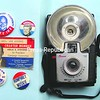 Some of Alvin Reiner's campaign-paraphernalia collection includes buttons, his mother's official Adlai Stevenson card and a Kodak Brownie Starflash camera like the one he used to take John F. Kennedy's photo.<br><br>(Staff Photo/Alvin Reiner)