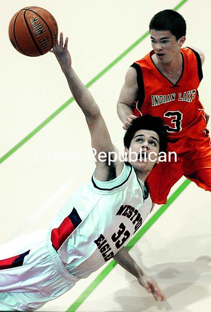 Westport's Michael Tyler (33) dives for the ball to try and keep it from going out of bounds during Thursday's Class D boys' basketball semifinal. Indian Lake/Long Lake's Jeff Reynolds (3) looks on. The Eagles recorded a 56-52 victory at the Plattsburgh State Field house. Bonus photos at www.pressrepublican.com<br><br>(Staff Photo/Michael Betts)