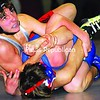 Beekmantown's Jesse Daniels looks to lock up Peru's Troy Seymour during their 103-pound match Wednesday night. Daniels recorded a 4-2 victory in one of the better matches of the evening. Bonus photos from this match will be at www.pressrepublican.com by midday. <br><br>(P-R Photo/Rachel Moore)