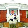 Port Henry Village Mayor Gary Cooke stands in front of the Village Hall on Main Street.<br><br>(Staff Photo/Lohr McKinstry)