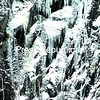 A climber navigates a wall by Chapel Pond in Keene Valley while a belayer stands in the lower right of the photo. Milder temperatures this week will melt away some of the frozen surface that climbers look for on mountains and ice anglers need on lakes.<br><br>(Staff Photo/Alvin Reiner)