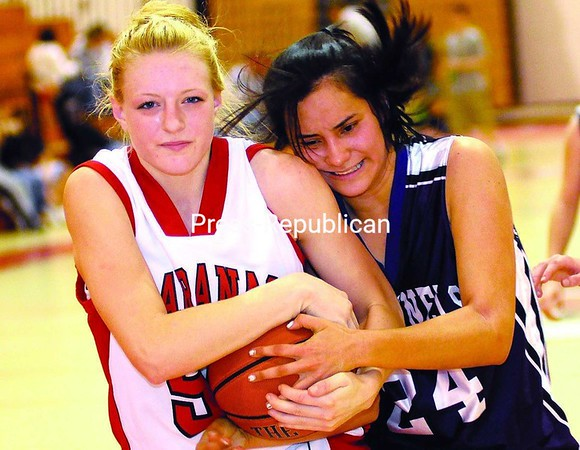Saranac's Hillari Favreau (40) and Ticonderoga's Jocelyn Barber wrestle for possession of basketball in action Saturday afternoon at the Field House. Saranac won game 47-17. Bonus photos of the game will be available on the pressrepublican.com website at midday.<br><br>(Staff Photo/Rob Fountain)