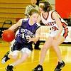 Ticonderoga's Samantha Diehl drives around Plattsburgh High's Emily Higgins in CVAC girls' basketball action Tuesday night at PHS. The host Hornets won, 50-40.<br><br>(Staff Photo/Michael Betts)