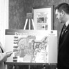 In The Development Corporation offices earlier this week, President Adoré Flynn Kurtz and Facilities and Project Manager Keith Matott explain plans for redevelopment of the Clinton County Airport property. <br><br>(P-R Photo/Kelli Catana)