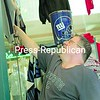 Ron Conners of Plattsburgh hangs Super Bowl merchandise the week before the big game.<br><br>(P-R Photo/Kelli Catana)