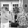 "Beverly Peryer, 67, of Altona and Liz Rizzie, 73, of Cadyville dance to the Back Porch Band during a senior picnic held at Saranac Town Hall. ""It's a good way for seniors to get out and socialize,"" said Jan Dean, director for the Nutrition Program for the Elderly. Though not always picnics, midday meals are served Wednesdays and Thursdays throughout the year at eight locations in Clinton County. <br><br>(P-R Photo/Kelli Catana)"