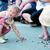 Two-year-old Cheyenne Cosgrove (left) of Plattsburgh, who was born on the Fourth of July, shares her birthday with America. Here, she and Anna Plaza, 2, of Chazy grab candy coming out of a mini cement mixer during the Plattsburgh parade.<br><br>(P-R Photo/Kelli Catana)