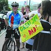 Tom Monks wore a big smile as he arrived in Lake Placid near noon Tuesday, riding his bike from Jones Beach to Lake Placid on a Cloud Splitter course to raise awareness and funds for AIDS.<br><br>(Staff Photo/Kim Smith Dedam)