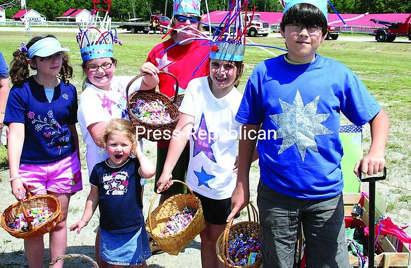 Youngsters representing the Phoenix 4-H Club have their baskets laden with treats, prepared to march down Main Street Saturday in the Westport Independence Day Parade.<br><br>(Staff Photos/Alvin Reiner)