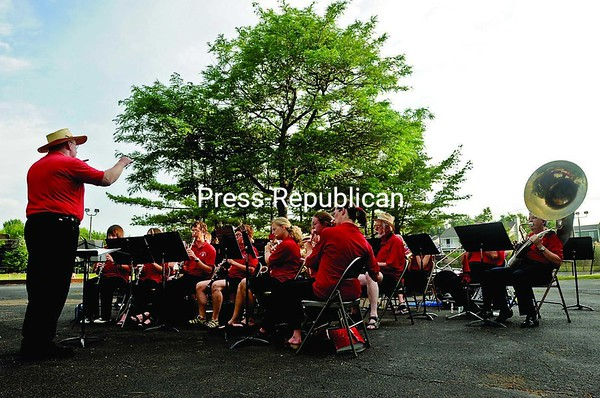 "The Strawhatters Concert Band plays ""When the Saints Come Marching In"" during a free concert at Peter S. Blumette Park in Plattsburgh Wednesday. The band entertained the crowd with marches, patriotic numbers and dixieland melodies.<br><br>(Staff Photo/Michael Betts)"