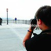 Joshua Gero takes a photo of the new Montgomery Street Pier during the grand-opening ceremony for the waterfront project Friday in Rouses Point. The redevelopment of the Montgomery Street waterfront included the pier, shoreline work, walkway, improved boat launch and pavilion. The improvements were made possible by several state and local grants and donations.<br><br>(Staff Photo/Rob Fountain )