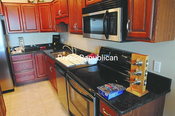 Granite countertops are another available upgrade. The owner can choose the color of the standard oak or maple cabinets at no extra cost.<br><br>(Staff Photo/Michael Betts)