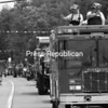 Volunteers from the Beekmantown Fire Department wave to the crowd from on top of one of their fire engines during the Cadyville Field Day parade Sunday on Route 3. The Field Day featured family games, children's activities and prizes. Additional photos from the parade can be viewed in the galleries at www.pressrepublican.com.<br><br>(P-R Photo/Rachel Moore)