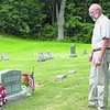 The Rev. David Hirtle stands by the resting place of Robin Murdock, the former caretaker of the community-owned Forest Dale Cemetery in Crown Point. Hirtle and board members are seeking support and financial aid to maintain the gift to the town.<br><br>(P-R Photo/Bethany Kosmider)