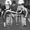 Jordan Hall of Peru (left) shakes hands with opponent Brennen Lamora of Beekmantown before their match at Saturday's Beekmantown Pee Wee Wrestling Tournament. The tournament filled the Beekmantown Central School auditorium with young wrestlers practicing their skills while being officiated by past and present wrestlers for Beekmantown High School.<br><br>(P-R Photo/Rachel Moore)