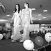 Taylor Lacey (left) and Kailee Favaro walk the runway at the Sweet N' Sassy Under the Sun: Prom and Spring Fashion show at Champlain Centre mall Saturday. The fashion show featured the newest prom styles along with trendy spring outfits.<br><br>(P-R Photo/Rachel Moore)