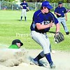 Scotty Morris of Elizabethtown-Lewis slides safely into third base as throw eludes Westport's Colin MacIver in Section VII Class D baseball playoff Thursday in Westport. Westport won 18-14.<br><br>(Staff Photos/Alvin Reiner)
