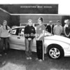 Posing with the car donated by Knight Automotive are Beekmantown High School class officers (from left) Shawn Adas; Chelsey Chatland, vice president; Beth Trombley, secretary; Meaghan LaValley, president; Garth Frechette, principal; Nathan Bull, treasurer; and Hillary Sponable. Beekmantown, Plattsburgh High, Chazy and Moriah are among the local schools that sponsor after-prom parties.<br><br>(Staff Photo/Rob Fountain)
