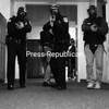Plattsburgh City Police officers walk in formation Sunday down a hallway at Stafford Middle School during a school-shooting training session.<br><br>(P-R Photo/Rachel Moore)