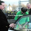 Matthew Card is escorted to a police car Friday afternoon. Card is accused of committing more than 17 arsons over the last few years.<br><br>(P-R Photo/Michael Betts)