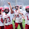 Ecstatic Moriah players leave the field in Hudson Falls last Saturday after defeating Rensselaer 19-0 in the state Class D quarterfinals in football. The Vikings are, from left to right: Nick Gilbo (44), Ron Schofield (23), Ben Tromblee (62)  and Nate Gilbo (10). Moriah will take on Tuckahoe at 4 p.m. today at Dietz Stadium in Kingston in the semifinals. <br><br>(P-R Photo/Michael Betts)