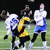 Seton Catholic's Renee Egan (16) and Kate Murnane (12) battle with Northern Adirondack's Lindsay Boulerice (7) for possession of the ball during Wednesday night's Class C girls' soccer championship game. Murnane scored the game's first goal and Egan added three assists in the Knights' 5-0 victory.<br><br>(P-R Photo/Michael Betts)
