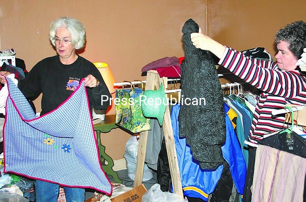 Volunteers Janet Cross (left) and Pat Blades sort through items to be stocked at the E-Town Thrift Shop. The new store, which will be run by Elizabethtown-area churches, will give people somewhere to shop for reasonably priced clothing and household goods.<br><br>(Staff Photo/Alvin Reiner)